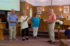 05 Dean Peters, Susie Stowell, and Janice Allen accept some tokens that were given to Rev. Dick on his arrival at St. Paul's