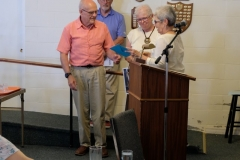 23 Susie Stowell presents Rev Dick with a tablet computer