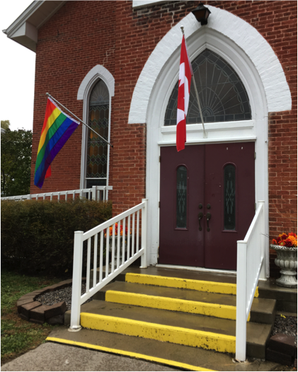 Rainbow flag flying proudly at entrance to St. Paul's United Church, Warkworth, Ontario